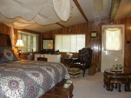 Time After Time Bed and Breakfast: Safari Room King Bed, Outside Door to Grounds