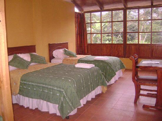 Bio Hostal Mindo Cloud Forest: All room have comfy beds and private bathrooms.