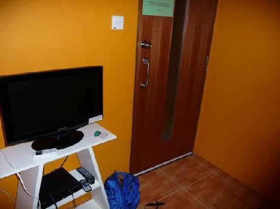 The InnCrowd Hostel: TV and shelf to the front of the twin room.
