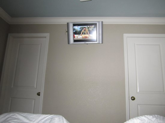 a very small flat screen tv this is a view from the bed