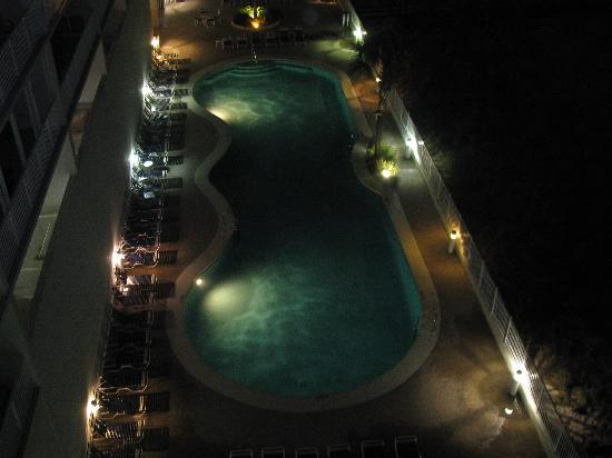 The Lighthouse Condominiums: The pool area at night.