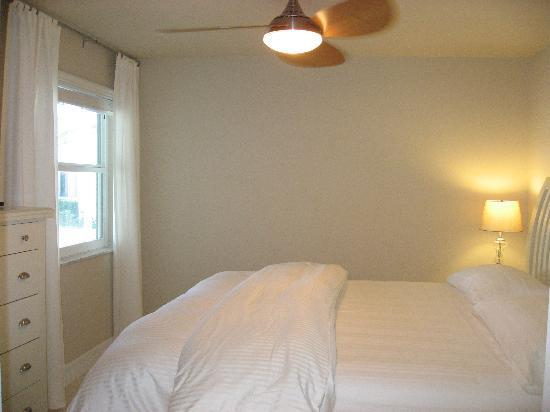 Sandy Toes Beach Rentals: Coast condo king bedroom with TV and ensuite bathroom