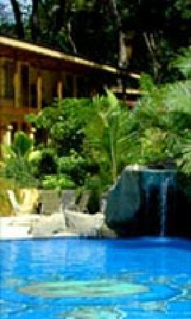 DoceLunas Hotel, Restaurant & Spa: Pool, Waterfall Cave, and Deluxe Room Building