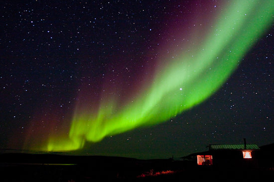 Yellowknife, Canada: Northern Lights over the cabins