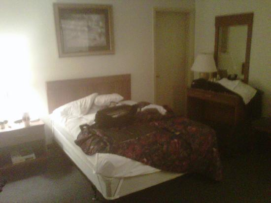 Castleberry Inn &amp; Suites - GA Dome: View of our small, hard bed with burn holes in the sheets!