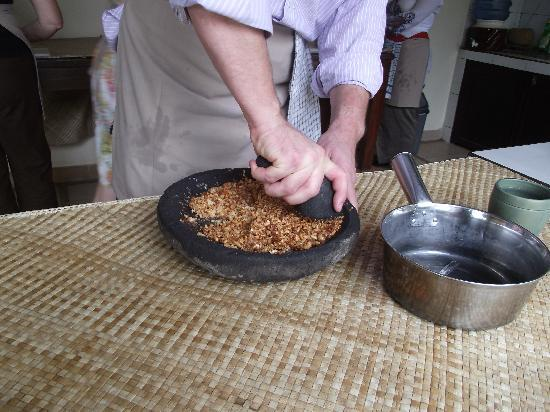 http://media-cdn.tripadvisor.com/media/photo-s/01/c8/05/49/making-peanut-sauce.jpg