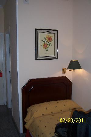 Hotel Maestranza: View of Room 102's bed, artwork