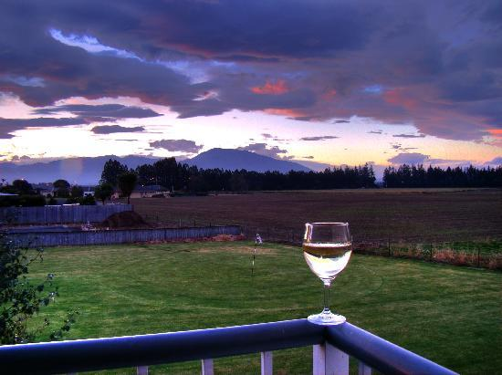 Brinkley Resort: enjoying a glass of wine overlooking a quiet sunset