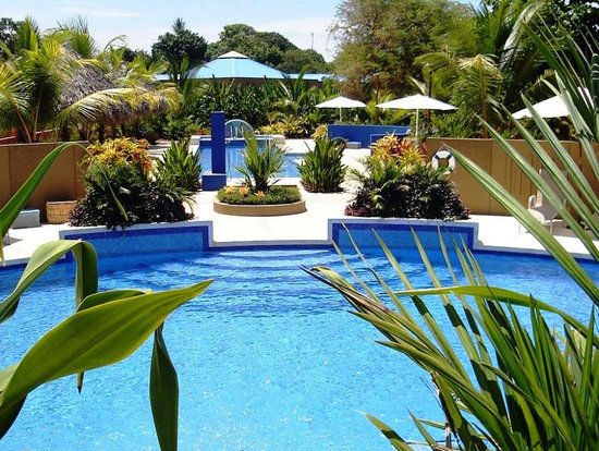 Alma del Pacifico Beach Hotel & Spa: Alma's pool, perfectly situated within a tropical garden setting.