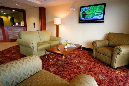 "Comfort Inn & Suites: Sitting Area in Lobby... for that ""At-Home"" feel"