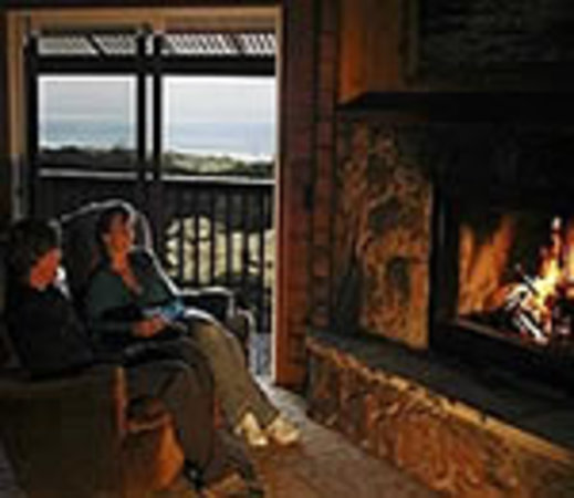 Ireland's Rustic Lodges: Enjoy the warm fire & the crashing sea.
