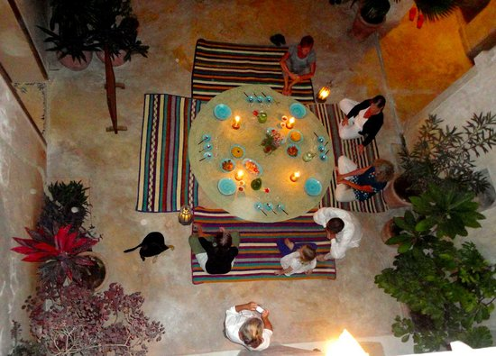 Subira House: Sometimes we dine on the floor in the Open Court Yard