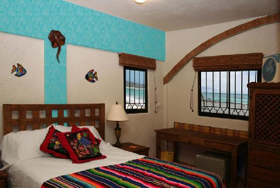 The Taj Majahual: The Beachy Ceviche Bedroom offers a more rustic environment, with beach access just steps away.