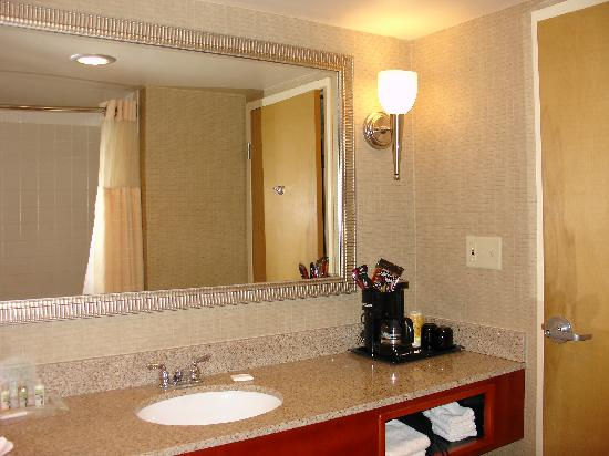 Holiday Inn Hotel & Suites Cincinnati-Eastgate: Bathroom vanity and coffee-maker, hair-dryer is inside the cubby hole