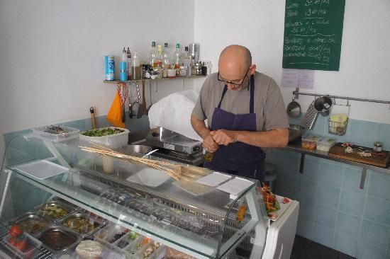 Fayence, France: the chef preparing his dishes - open kitchen