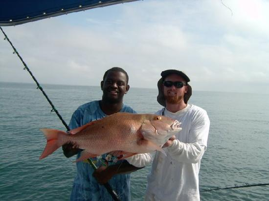 Capt dan and me picture of key west fishing connection for Mackinaw city fishing charters