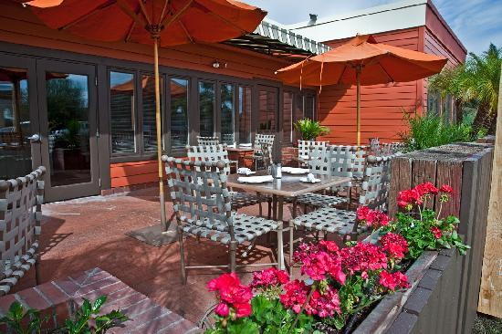 restaurant features many different dining areas including an outdoor