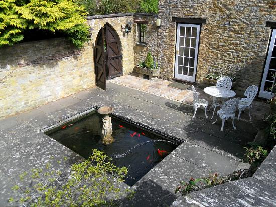 The fish pond picture of swan lodge chipping norton for Build a koi pond yourself