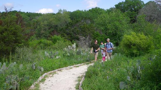 San Marcos, TX: Hikers along Purgatory Creek Natural Area Trails