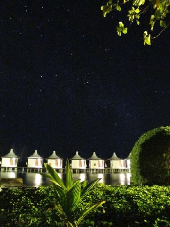 Meemu Atoll: a starry night above the water bungaloes