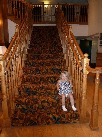 ‪‪Country Inn & Suites by Carlson, Rapid City‬: My daughter~ Sitting on stairs in entry way‬