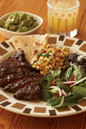 Grilled skirt steak w/ corn relish, black beans, tomato avocado salad ...