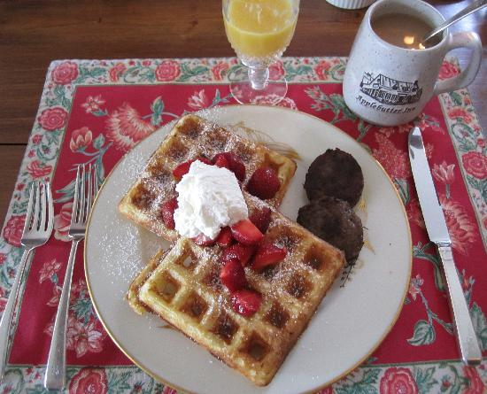 Applebutter Inn: Light and fluffy homemade waffles with maple sausage. YUM!