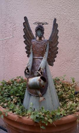 decorative planter angel at adobe rose inn