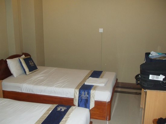 Le Grand Mekong: A single and a double bed