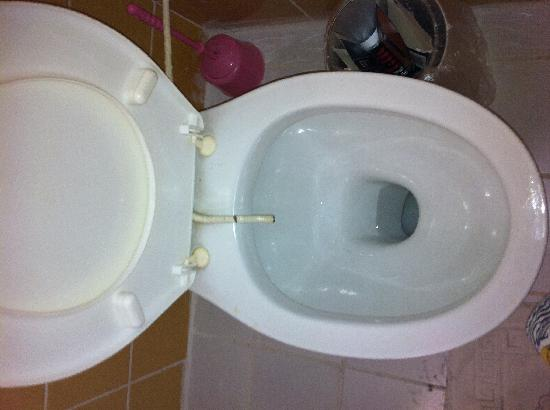 Hotel Gold Stone: PIPE STICKING OUT THE TOP OF TOILET