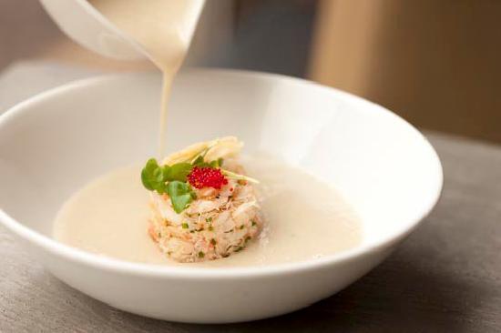 Restaurant TABLE: CALIFLOWER CREAM WITH SNOW CRAB diced potatoes and ...