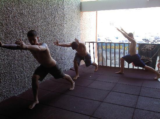 , : The boys doing their Insanity workout in the mornings