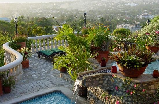 Pool area and view of pap and ocean for Garden pool haiti