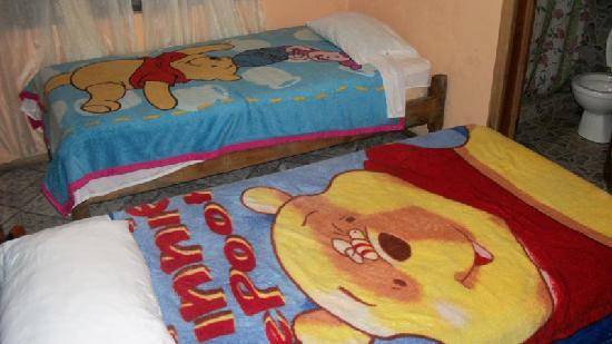 Sleepers Sleep Cheaper Hostel: Our first room, complete with Disney blankets ;)