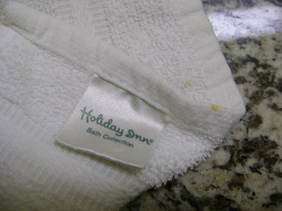 Holiday Inn Express - Air Force Academy: stained towels (And no denying who's towels they are!)
