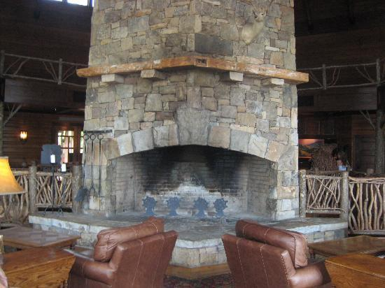 stack stone fireplace in large sitting area has beautiful ...