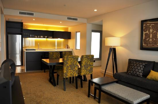 grand papua hotel 1 bedroom apartment living room