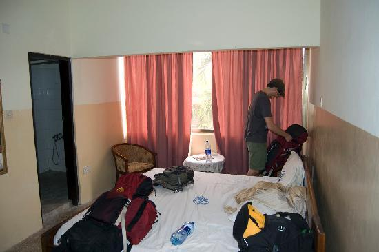 Cape Coast, Ghana: My husband inside our hotel room. The mess is ours!