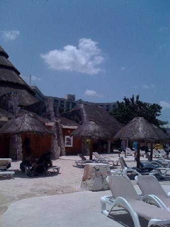 Park Royal Cozumel : Poolside lounge area with hotel in the background