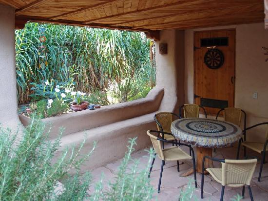 Adobe Nido Bed &amp; Breakfast: Covered area off garden is perfect for reading or a snack