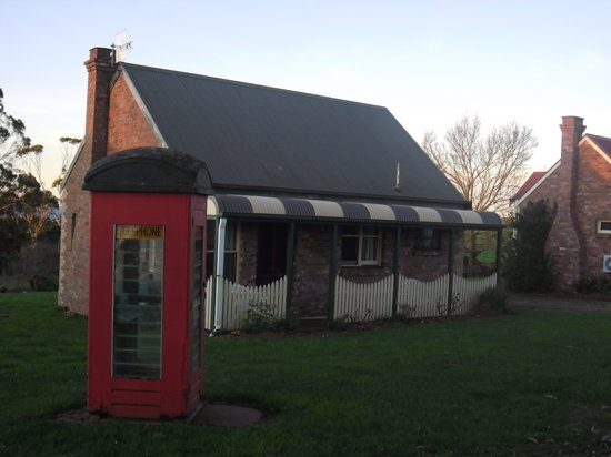 Killynaught Spa Cottages: Victoria&#39;s Cottage and telephone box