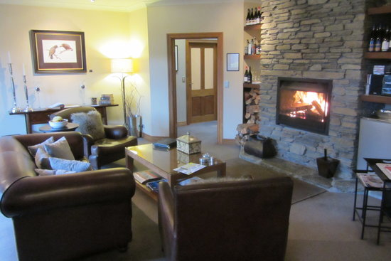 The Dairy Private Luxury Hotel: Lounge, fire, comfort, bliss