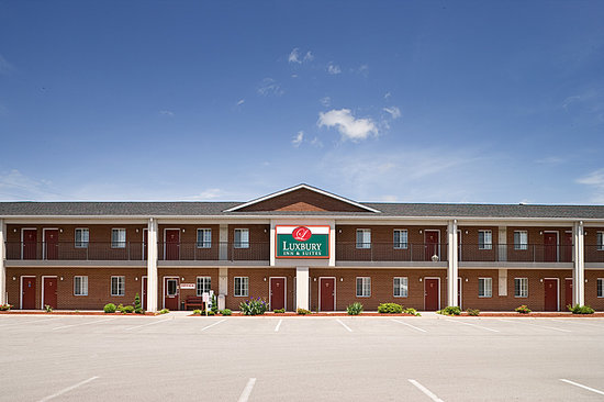 ‪Luxbury Inn & Suites‬