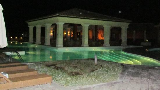 Grecotel Eva Palace: The pool bar at night