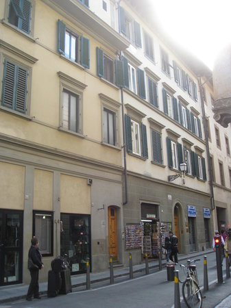 B & B Novecento: View of building with the B&B window  above the postcard rack on the sotre front. Entry to B&B i