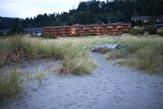 Gold Beach Resort and Condominiums: Evening view of hotel from the beach.