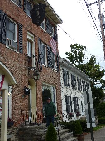 Standing on the front steps of the Tunnicliff Inn
