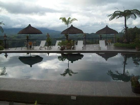 San Carlos City, Filipina: poolside huts, overlooking the hillside