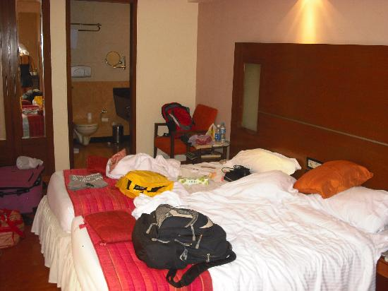 Shervani New Delhi: Room with 2 beds together - sorry for the mess!