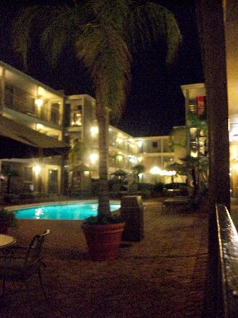 Ramada Metairie: courtyard pool area at night